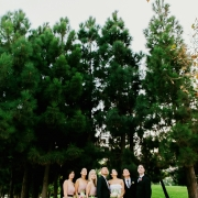 Wedding party looking up at a San Francisco wedding by destination wedding planner Mango Muse Events
