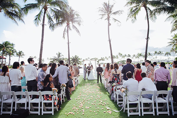 Beach wedding ceremony at the Hilton Hawaiian Village in Hawaii by destination wedding planner Mango Muse Events