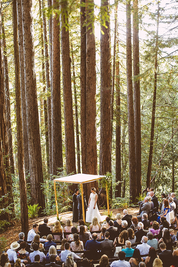 Woodland wedding ceremony in the middle of the redwoods in Santa Cruz at the Sequoia Retreat Center by destination wedding planner Mango Muse Events