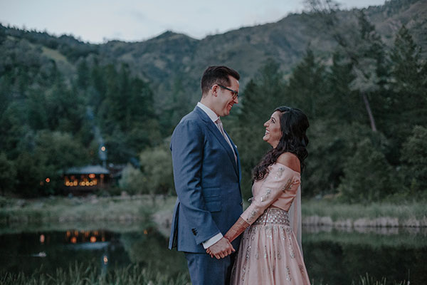 A smitten bride and groom at their Calistoga Ranch multi-cultural wedding by destination wedding planner Mango Muse Events