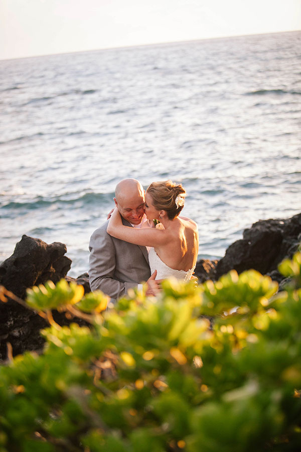 Bride and groom sharing a moment and a whisper at their Big Island Wedding in Hawaii by destination wedding planner Mango Muse Events