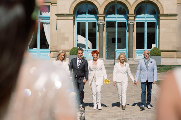 First look with parents at a lesbian wedding in Amsterdam by destination wedding planner Mango Muse Events