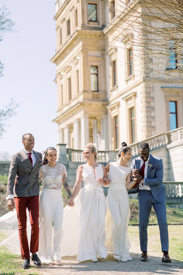 Mixed wedding party having a moment at a same sex wedding in Amsterdam by destination wedding planner Mango Muse Events