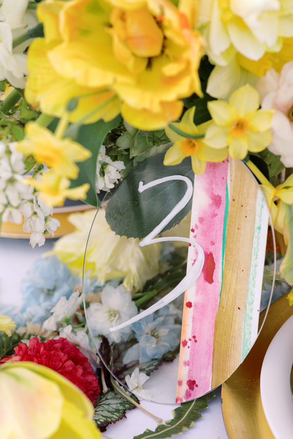 Painted acrylic table number for a floral spring wedding in Amsterdam by destination wedding planner Mango Muse Events