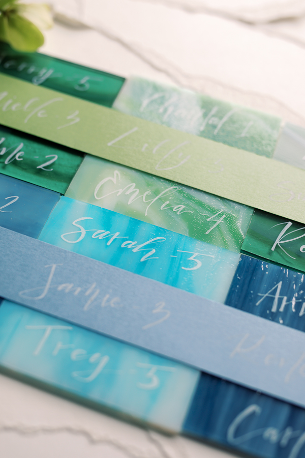 Painted blue and green escort cards for a spring wedding in Amsterdam by destination wedding planner Mango Muse Events