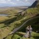 Bride and groom enjoying the view at the Quiraing on the Isle of Skye wedding in Scotland by Destination wedding planner Mango Muse Events