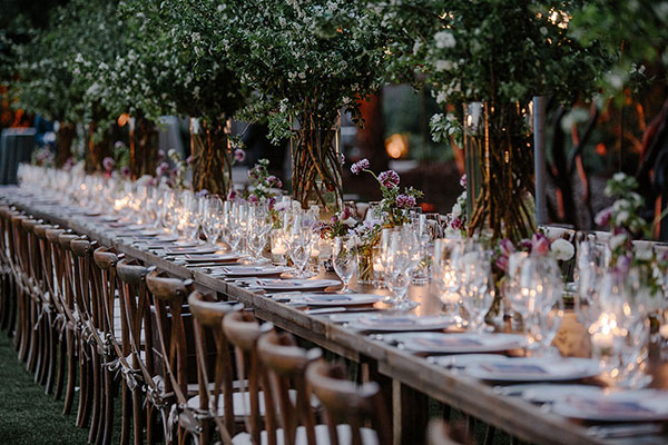 Tall flowering Hawthorne branch centerpieces and a beautiful tablescape for a Calistoga Ranch destination wedding by destination wedding planner Mango Muse Events
