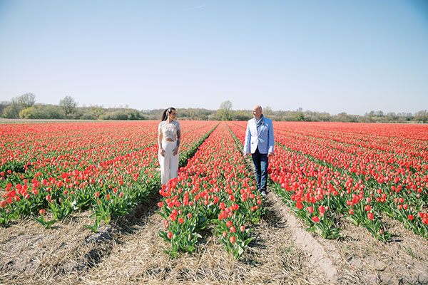 Bride and father of the bride getting ready to walk down the aisle at a wedding ceremony in the tulip fields in Holland by destination wedding planner Mango Muse Events