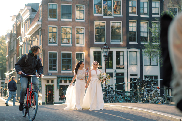 Two brides taking a stroll at their same sex wedding in Amsterdam by destination wedding planner Mango Muse Events