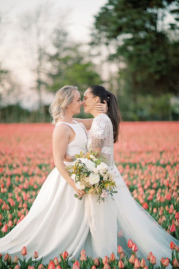 Two brides at their tulip fields wedding in the Netherlands by destination wedding planner Mango Muse Events