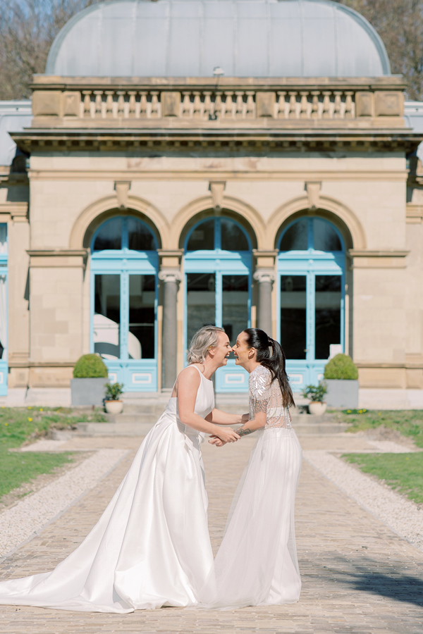 Two happy brides at their wedding at Orangerie Elswout in Holland by destination wedding planner Mango Muse Events