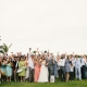 Everyone photo with the married couple and guests at a wedding in Hawaii by destination wedding planner Mango Muse Events