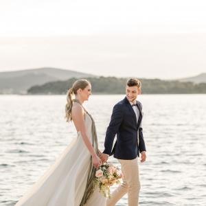 Bride and groom at their seaside wedding in Zadar Croatia by destination wedding planner, Mango Muse Events