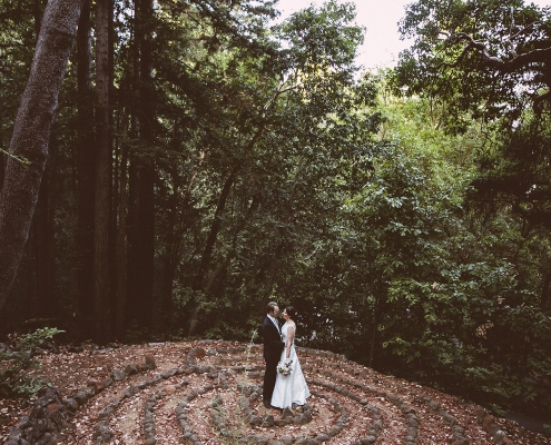Newlywed couple moment in a labyrinth circle at their woodland wedding at the Sequoia retreat center by destination wedding planner Mango Muse Events