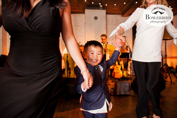 ring bearer dancing at a wedding reception at the Marin Headlands Center for the Arts by destination wedding planner Mango Muse Events
