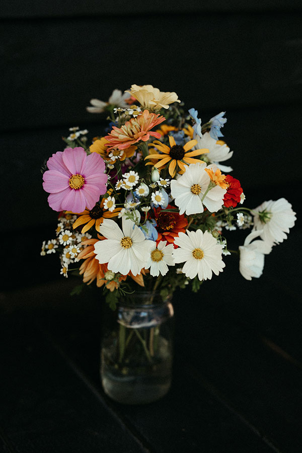 Colorful wildflower bridal bouquet for a Yosemite destination wedding by destination wedding planner Mango Muse Events