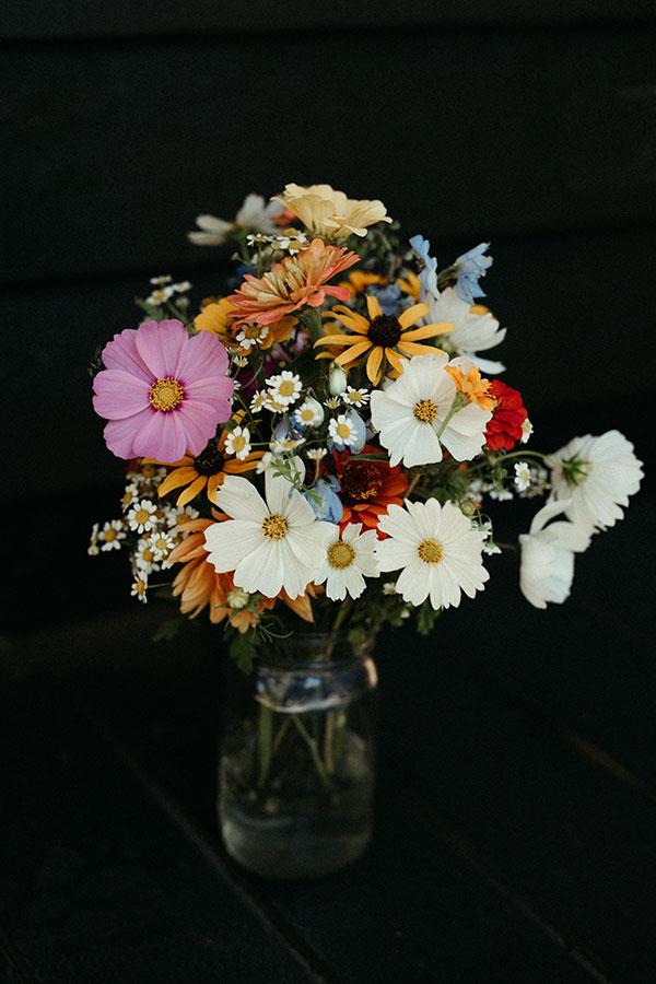 Colorful wildflower bridal bouquet for a Yosemite destination wedding by destination wedding planner Mango Muse Events