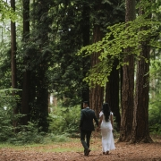 Bride and groom enjoying a moment in Stanley park at their modern Vancouver destination wedding by San Francisco based destination wedding planner Mango Muse Events