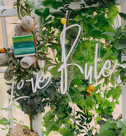 Love rules neon sign at an intimate wedding by San Francisco wedding planner Mango Muse Events founder of Let's I do this wedding virtual wedding packages