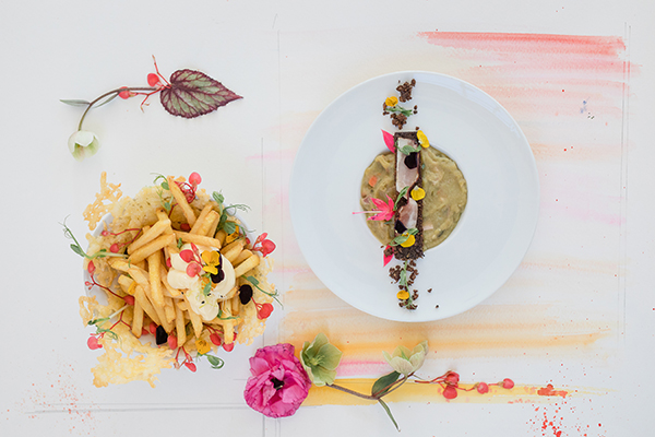 Two wedding meal courses, fries and mayonaise and traditional Dutch split pea soup for a wedding in Amsterdam Netherlands by destination wedding planner Mango Muse Events