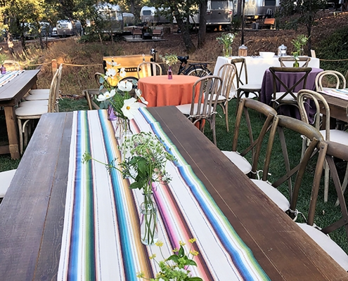 Mexican blanket inspired table runner for a colorful rehearsal dinner at Autocamp Yosemite by destination wedding planner Mango Muse Events