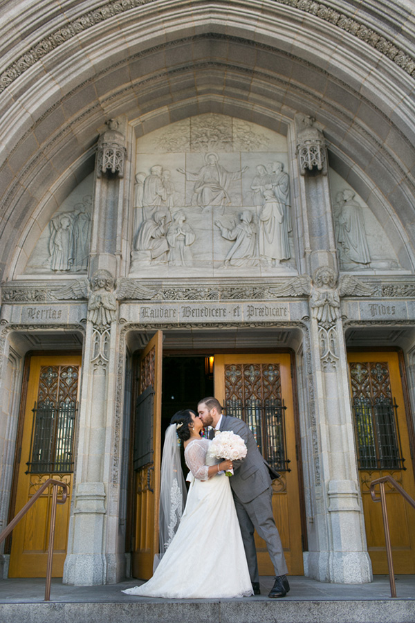 Bride and groom sharing a kiss at their elegant church wedding in San Francisco by destination wedding planner Mango Muse Events