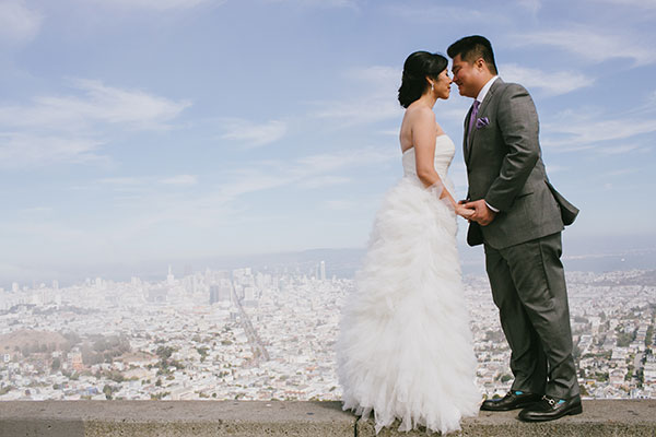 Bride and groom enjoying a moment and city views at their San Francisco wedding elopement by San Francisco Bay Area destination wedding planner Mango Muse Events