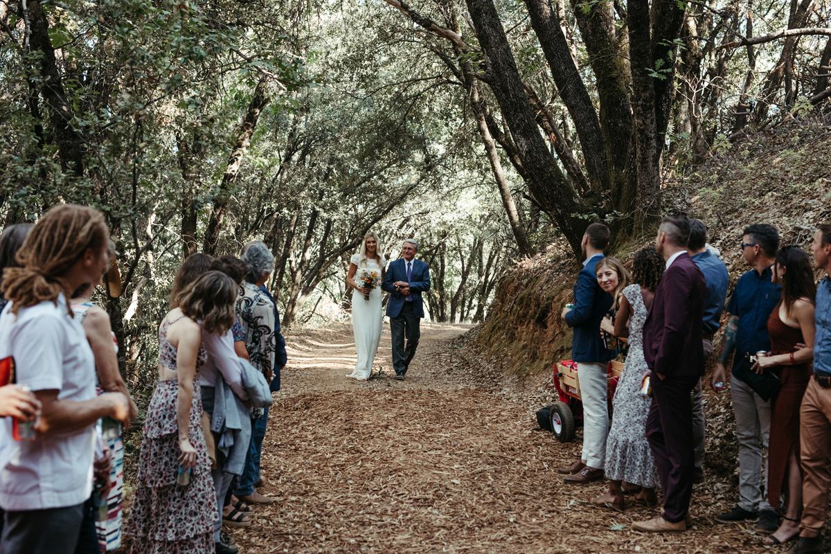 Bride and father of the bride walking down the aisle at an intimate mountain wedding in Yosemite by destination wedding planner Mango Muse Events