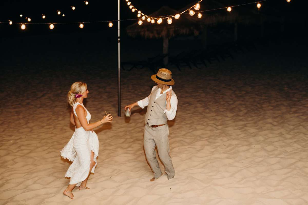 Bride and groom dancing at their beach wedding in Anguilla Caribbean at the Frangipani resort by destination wedding planner Mango Muse Events