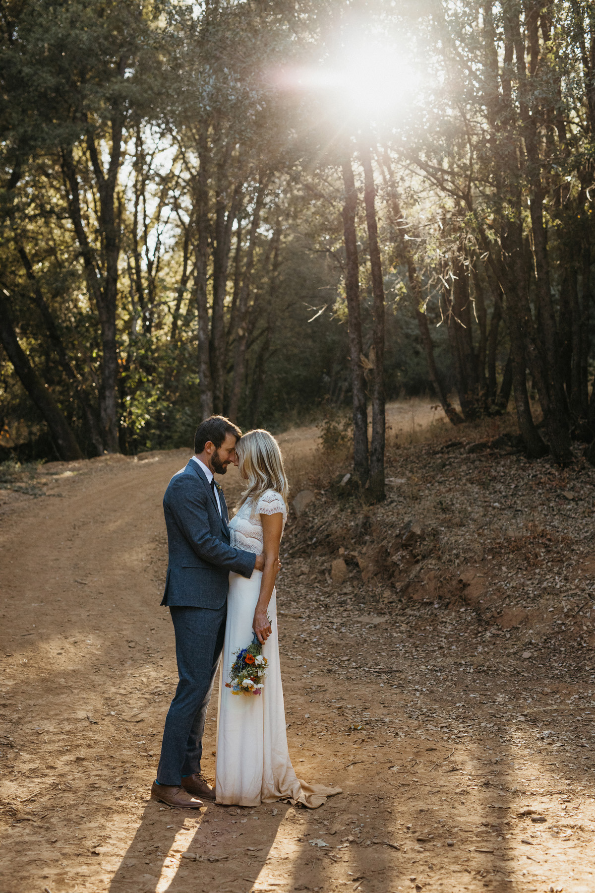 Bride and groom having an intimate moment at their boho mountain wedding in Yosemite by destination wedding planner Mango Muse Events