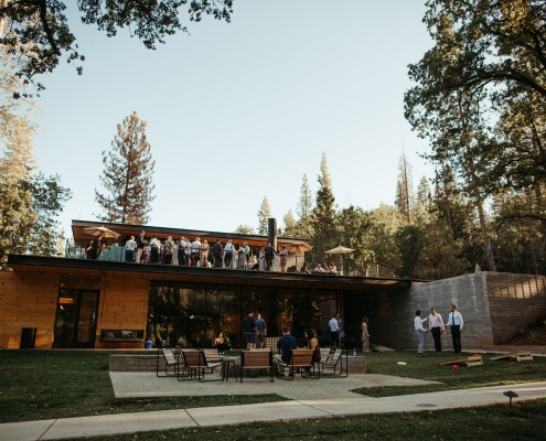 Cocktail hour lawn games at a mountain wedding at Autocamp Yosemite by destination wedding planner Mango Muse Events