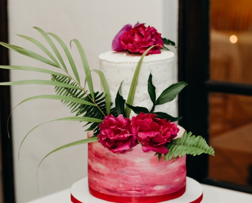Fuchsia tropical coconut wedding cake for an Anguilla Caribbean wedding by destination wedding planner Mango Muse Events