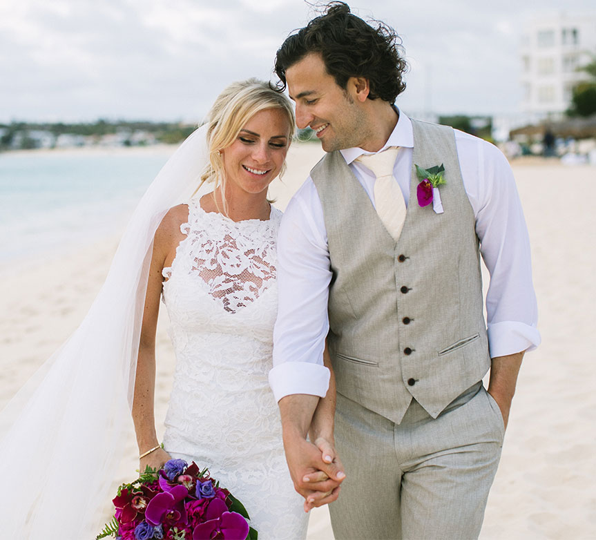 Happy couple at their fun tropical wedding on the beach in Anguilla Caribbean by destination wedding planner Mango Muse Events