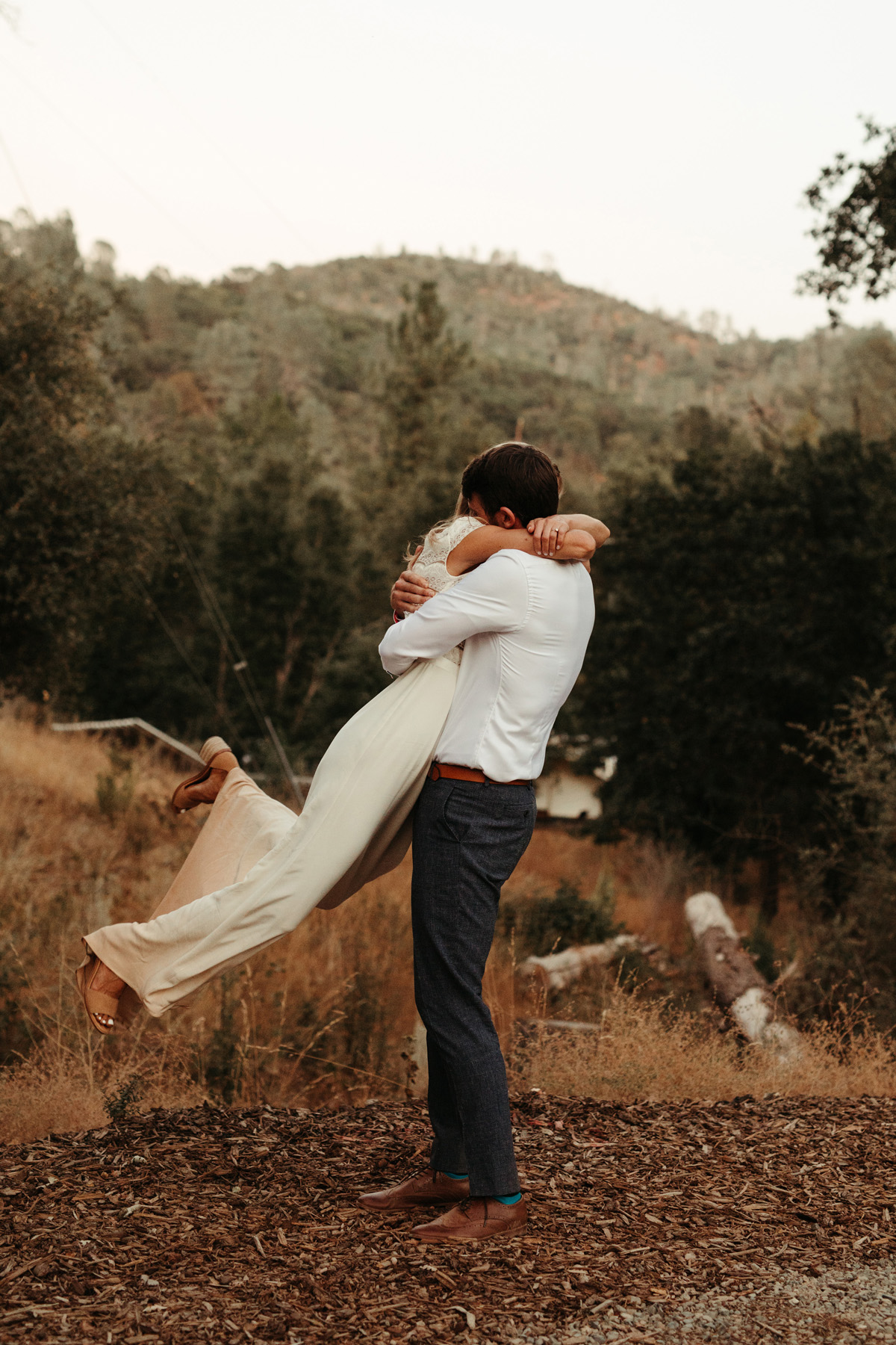 Happy couple hugging at their mountain wedding in Yosemite by destination wedding planner Mango Muse Events