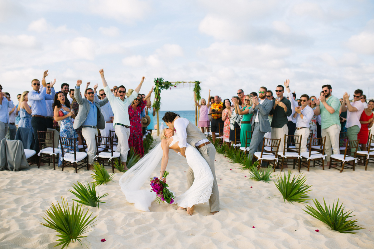 Bride groom just married kiss celebration at a beach wedding ceremony in Anguilla Caribbean by destination wedding planner Mango Muse Events