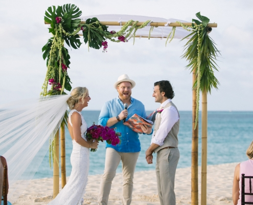 Tropical beach wedding ceremony chuppah in Anguilla Caribbean at the Frangipani Resort by destination wedding planner Mango Muse Events