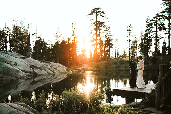 Bride and groom enjoying the sunset by the lake at their mountain wedding at a private estate in Tahoe by destination wedding planner Mango Muse Events