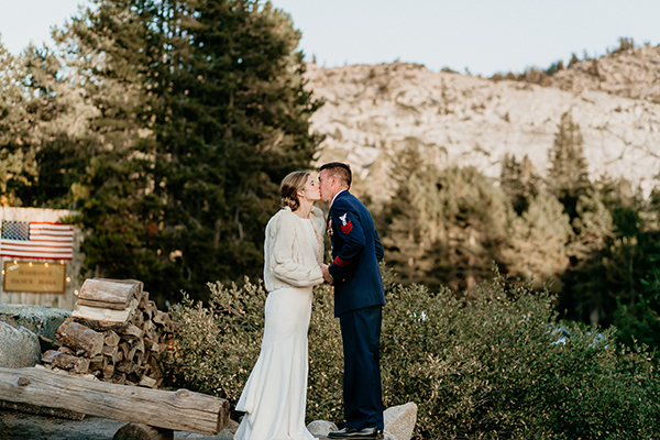 Bride and groom kiss at a military mountain wedding in Tahoe by destination wedding planner Mango Muse Events