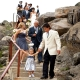 Wedding party walking down stairs to the beach at a Half Moon Bay wedding by Destination wedding planner, Mango Muse Events