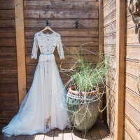 Fun and elegant black and white lace wedding dress with sleeves for a Calistoga Ranch wine country wedding by destination wedding planner Mango Muse Events