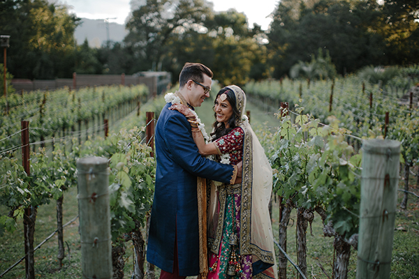 Bride and groom at their multicultural Hindu wedding in the vineyards at wine country venue Calistoga Ranch by destination wedding planner Mango Muse Events