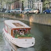 Wedding boat kiss at a lesbian wedding in Amsterdam by destination wedding planner Mango Muse Events