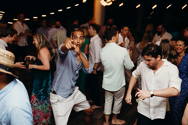 Wedding guests dancing and having a good time at beach wedding in Anguilla by destination wedding planner Mango Muse Events