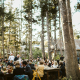 Guests enjoying themselves at a dinner wedding reception in Tahoe at the mountain private retreat The Hideout in Kirkwood by destination wedding planner Mango Muse Events